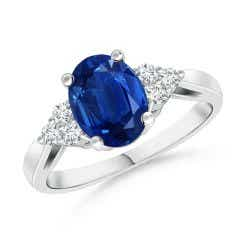 Oval Blue Sapphire Cocktail Ring With Trio Diamond Accents