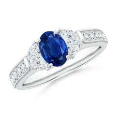 Oval Blue Sapphire and Half Moon Diamond Three Stone Ring