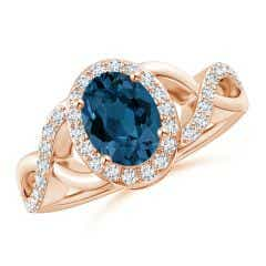 Oval London Blue Topaz Crossover Ring with Diamond Halo