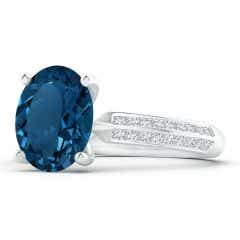 Classic GIA Certified Oval London Blue Topaz Knife Edge Ring
