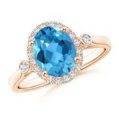 Classic Oval Swiss Blue Topaz Halo Ring with Bezel Accents