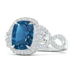 GIA Certified London Blue Topaz Crossover Ring with Halo