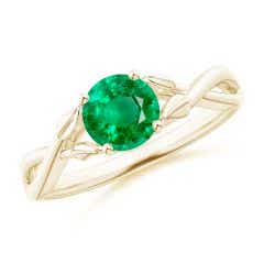 Nature Inspired Emerald Crossover Ring with Leaf Motifs