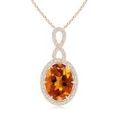 Oval Citrine and Diamond Halo Pendant with Infinity Bale