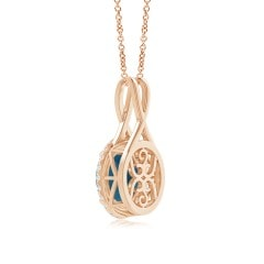 Toggle Solitaire London Blue Topaz Halo Pendant with Twisted Bale