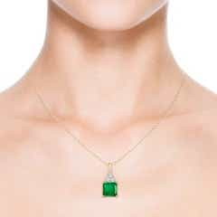 Toggle GIA Certified Emerald Solitaire Pendant with Trio Diamonds