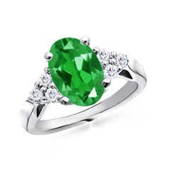 Oval Lab Created Emerald Cocktail Ring With Trio Diamond Accents