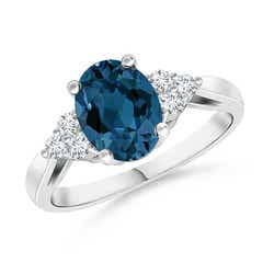 Oval London Blue Topaz Cocktail Ring with Trio Diamonds