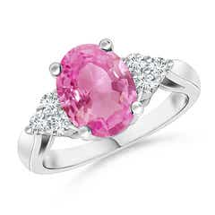 Oval Pink Sapphire Cocktail Ring With Trio Diamond Accents