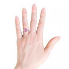 Toggle Oval Pink Sapphire Cocktail Ring With Trio Diamond Accents