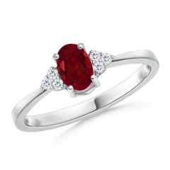 Tapered Shank Oval Garnet Ring with Trio Diamond Accent