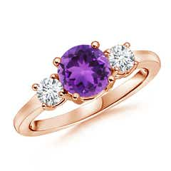 Classic Prong-Set Amethyst and Diamond Three Stone Ring