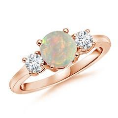 Classic Prong-Set Opal and Diamond Three Stone Ring