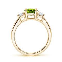 Toggle Classic Peridot and Diamond Three Stone Engagement Ring
