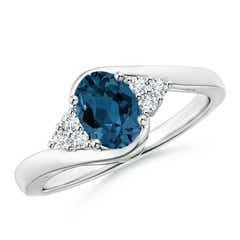 Oval London Blue Topaz Bypass Ring with Trio Diamonds