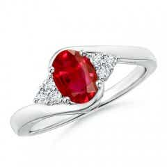 Oval Ruby Bypass Ring with Trio Diamond Accents