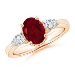 Oval Garnet Three Stone Ring with Pear Diamonds