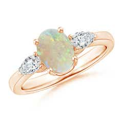 Oval Opal Three Stone Ring with Pear Diamonds