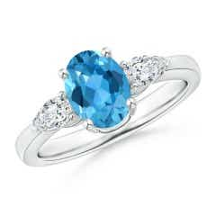 Oval Swiss Blue Topaz Three Stone Ring with Pear Diamonds