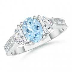 Oval Aquamarine and Half Moon Diamond Three Stone Ring
