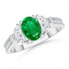 Oval Emerald and Half Moon Diamond Three Stone Ring