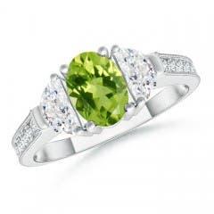 Oval Peridot and Half Moon Diamond Three Stone Ring