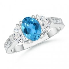 Oval Swiss Blue Topaz and Diamond Three Stone Ring