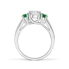 Toggle Classic Round Diamond and Emerald Three Stone Ring