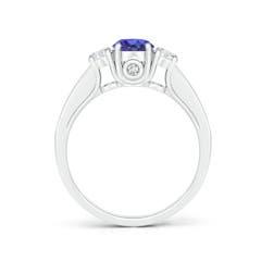 Toggle Classic Prong Set Round Tanzanite and Diamond Three Stone Ring