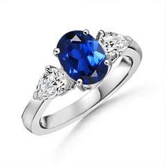 Lab Created Oval Sapphire and Diamond Three Stone Ring