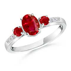 Oval Ruby Three Stone Ring with Diamond Accents