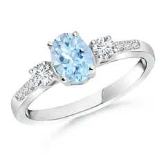 Classic Oval Aquamarine and Diamond Three Stone Ring