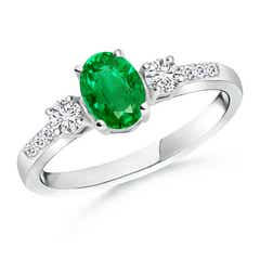 Classic Oval Emerald and Round Diamond Three Stone Ring