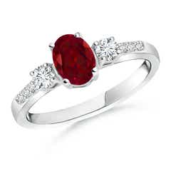 Classic Oval Garnet and Round Diamond Three Stone Ring