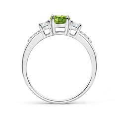 Toggle Classic Oval Peridot and Round Diamond Three Stone Ring
