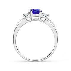 Toggle Classic Oval Tanzanite and Round Diamond Three Stone Ring