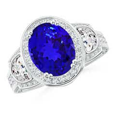 Half Moon Diamond and Oval Tanzanite Three Stone Ring