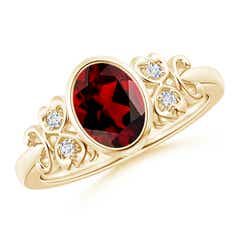 Vintage Oval Garnet Bezel Ring with Diamond Accents