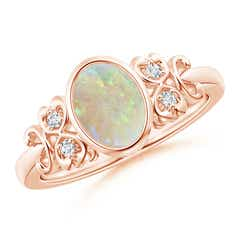 Vintage Oval Opal Bezel Ring with Diamond Accents