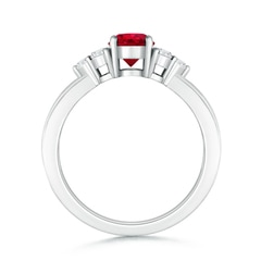 Toggle Round Ruby Solitaire Ring With Trio Diamonds