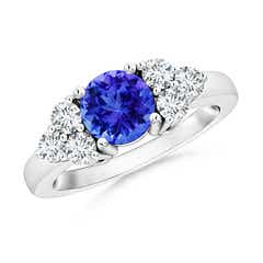 Round Tanzanite Solitaire Ring With Trio Diamonds