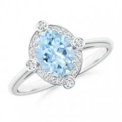 Deco Inspired Oval Aquamarine and Diamond Halo Ring