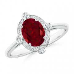 Deco Inspired Oval Garnet and Diamond Halo Ring