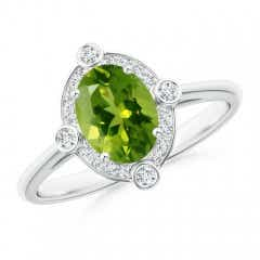 Deco Inspired Oval Peridot and Diamond Halo Ring