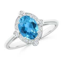 Deco Inspired Oval Swiss Blue Topaz and Diamond Halo Ring