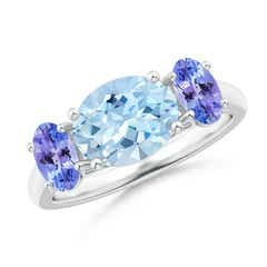 Prong-Set Oval Aquamarine and Tanzanite Three Stone Ring