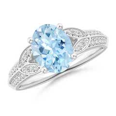 Knife-Edged Oval Aquamarine Solitaire Ring with Pave Diamonds