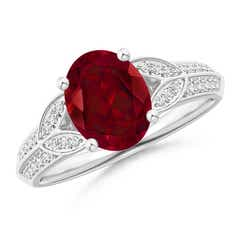 Knife-Edged Oval Garnet Solitaire Ring with Pave Diamonds