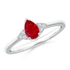 Pear Ruby Solitaire Ring with Trio Diamond Accents