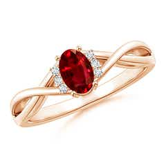 Oval Ruby Crossover Ring with Diamond Accents